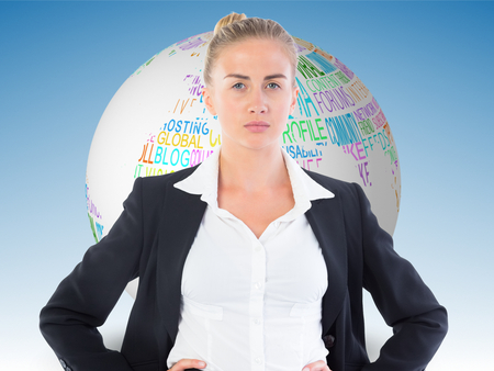composite image: Composite image of blonde businesswoman standing with hands on hips