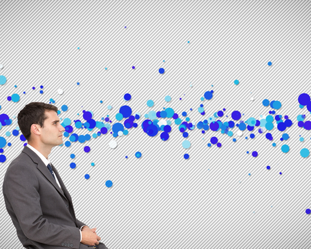 strips away: Composite image of classy young businessman sitting on white background