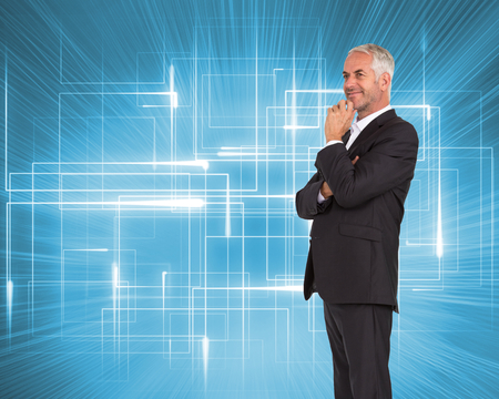Composite image of happy mature businessman looking away