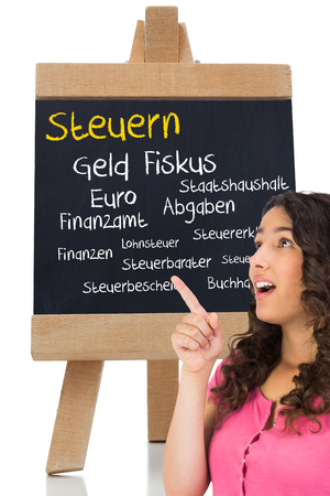 finanzen: Composite image of surprised brown haired woman pointing out