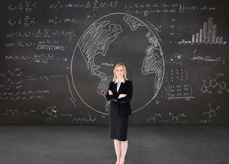 folded arms: Composite image of a confident businesswoman with folded arms
