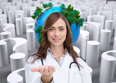 tree world tree service: Composite image of portrait of female nurse holding out open palm Stock Photo
