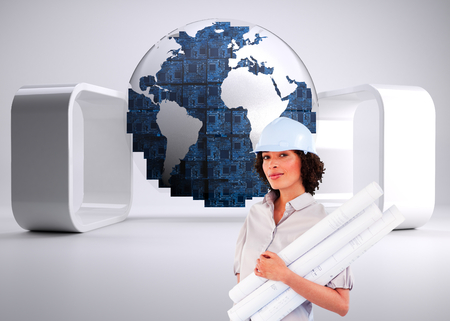 Composite image of confident woman holding construction plans photo