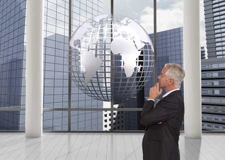 Composite image of thoughtful mature businessman posing photo