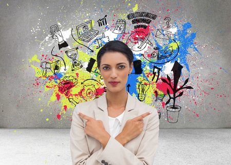 Composite image of charismatic businesswoman with her arms crossed and fingers pointing Stock Photo