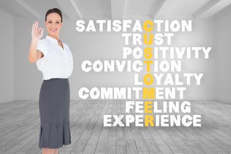 positivity: Composite image of elegant businesswoman showing an okay gesture on white background