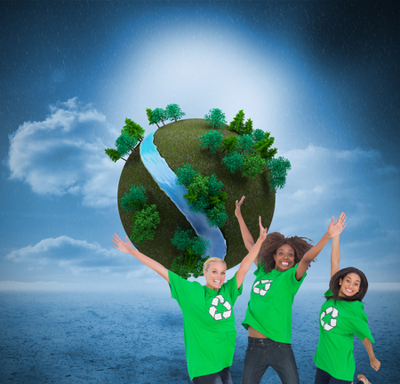 enviromental: Composite image of three enviromental activists jumping and smiling on white background