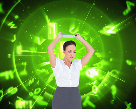 woman looking down: Composite image of angry businesswoman throwing her tablet pc while posing on white background