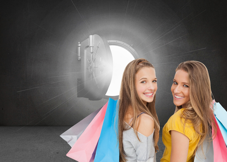 composite image: Composite image of two young women with shopping bags against white background