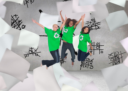 activists: Composite image of three enviromental activists jumping and smiling on white background