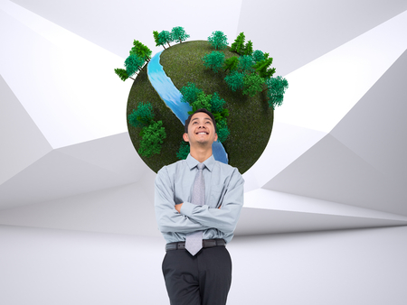 legs folded: Composite image of smiling asian businessman