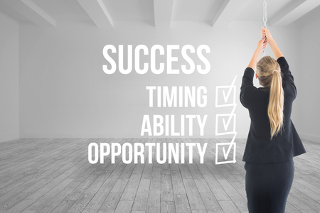 career timing: Composite image of blonde businesswoman pulling a chain