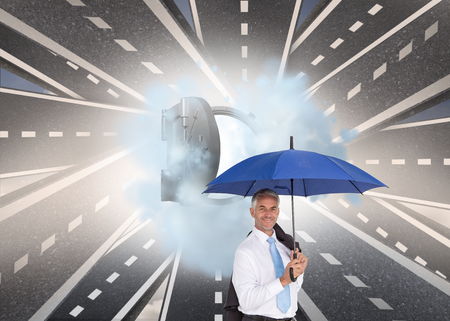 Composite image of businessman holding umbrella smiling at camera photo