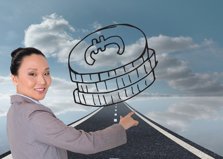 Composite image of smiling asian businesswoman pointing Stock Photo - 26947947