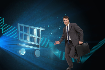 Composite image of smiling handsome businessman in a hurry photo