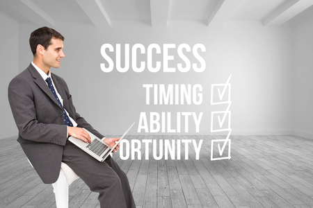 career timing: Composite image of businessman using laptop sitting on chair