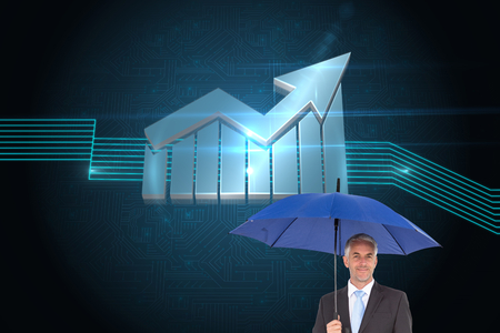 Composite image of businessman smiling at camera and holding blue umbrella photo