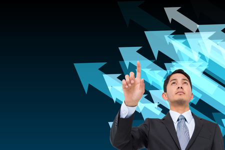 Composite image of serious asian businessman pointing photo