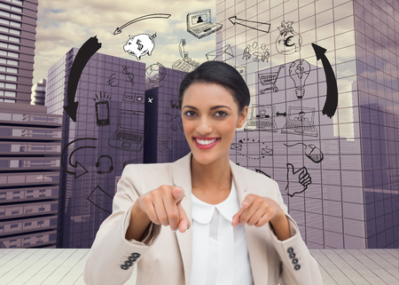 Composite image of smiling businesswoman pointing at the camera photo