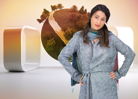 Composite image of serious pretty brunette wearing winter clothes posing photo
