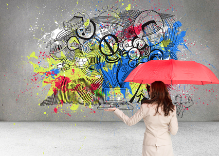 Composite image of brunette businesswoman holding umbrella photo