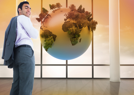 Composite image of smiling businessman standing photo