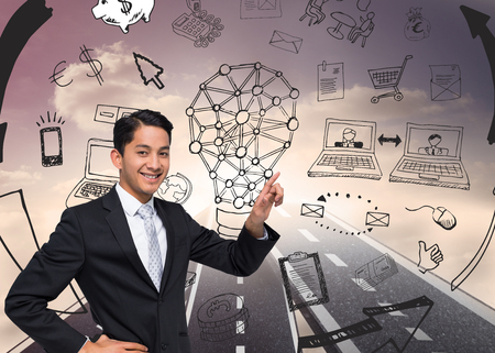 Composite image of smiling asian businessman pointing photo