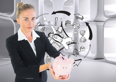 Composite image of blonde businesswoman holding piggy bank photo