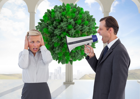 Composite image of businessman shouting at colleague with his bullhorn photo