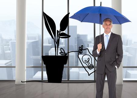 Composite image of businessman smiling at camera and holding blue umbrella photo