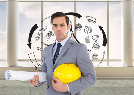 Composite image of serious architect holding plans and hard hat photo