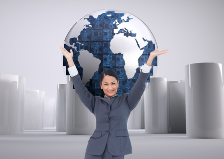 Composite image of cheering businesswoman photo
