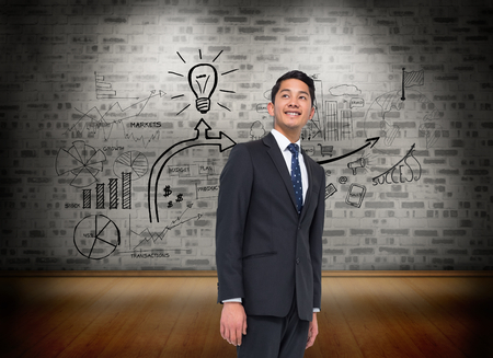 Composite image of smiling asian businessman photo