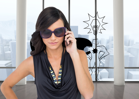 Composite image of serious elegant brunette wearing sunglasses on the phone Stock Photo