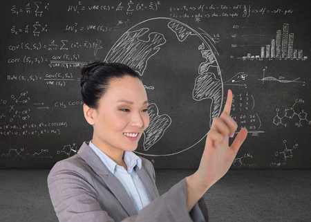 Composite image of smiling asian businesswoman pointing Stock Photo