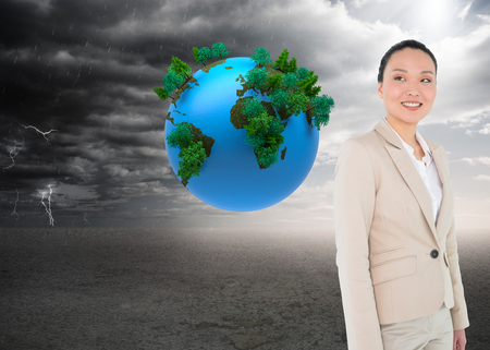 Composite image of smiling asian businesswoman photo