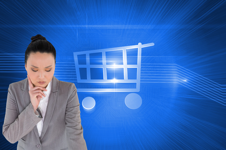 woman looking down: Composite image of thoughtful asian businesswoman pointing Stock Photo