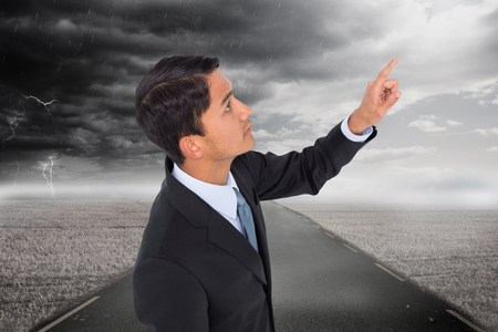 unsmiling: Composite image of unsmiling asian businessman pointing