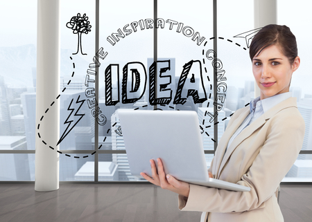 Composite image of confident young businesswoman with laptop photo