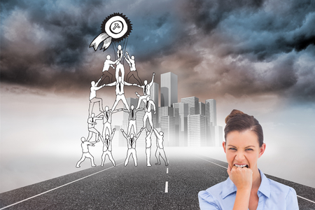 Composite image of furious businesswoman looking at the camera Stock Photo