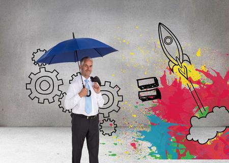 Composite image of happy mature businessman holding umbrella photo