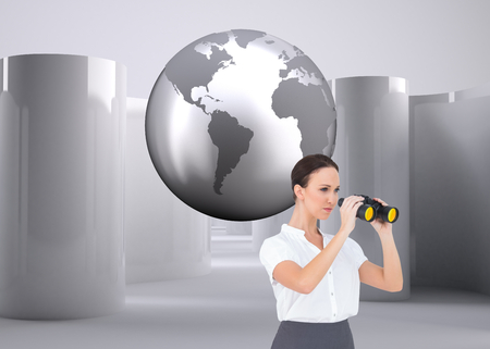 Composite image of serious elegant businesswoman looking through binoculars while posing photo
