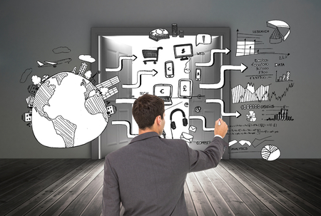 Composite image of businessman standing back to camera writing with marker photo