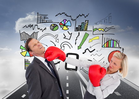 Composite image of businesswoman hitting colleague with her boxing gloves photo