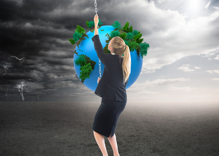 Composite image of blonde businesswoman pulling a chain photo