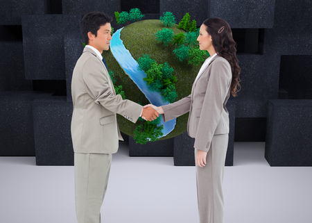 Composite image of side view of hand shaking trading partners photo