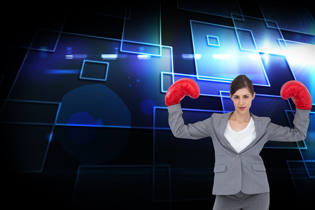 black empowerment: Composite image of businesswoman with boxing gloves