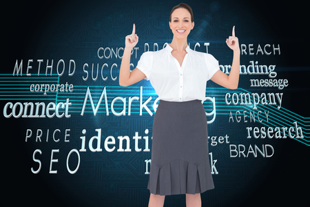 Composite image of smiling gorgeous businesswoman posing photo