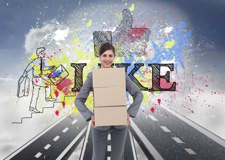 Composite image of smiling businesswoman carrying cardboard boxes photo