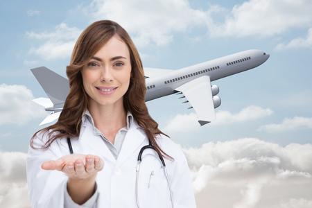 비행: Composite image of portrait of female nurse holding out open palm 스톡 사진